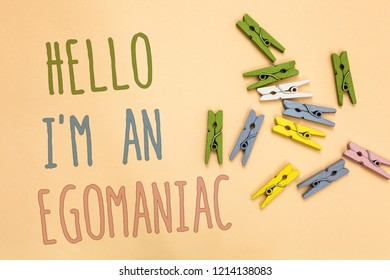 Text sign showing Hello I am An Egomaniac. Conceptual photo Selfish Egocentric Narcissist Self-centered Ego Yellow base with painted texts colorful paper clips laid randomly on ground.