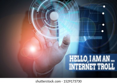 Text sign showing Hello I Am An Internet Troll. Conceptual photo Social media troubles discussions arguments Male human wear formal work suit presenting presentation using smart device.