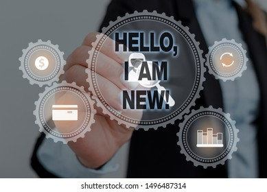 Text sign showing Hello I Am New. Conceptual photo used as greeting or to begin telephone conversation Woman wear formal work suit presenting presentation using smart device.