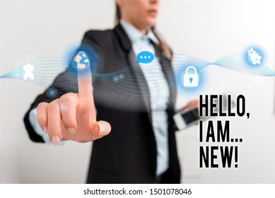 Text sign showing Hello I Am New. Conceptual photo used greeting or begin telephone conversation Female human wear formal work suit presenting presentation use smart device.