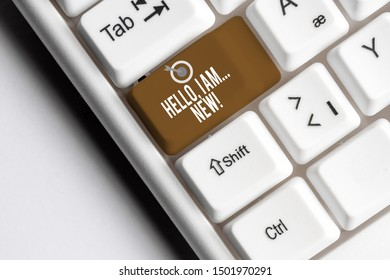 Text sign showing Hello I Am New. Conceptual photo used greeting or begin telephone conversation White pc keyboard with empty note paper above white background key copy space.