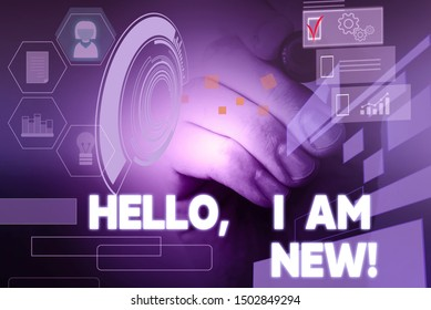 Text sign showing Hello I Am New. Conceptual photo used as greeting or to begin telephone conversation Male human wear formal work suit presenting presentation using smart device.