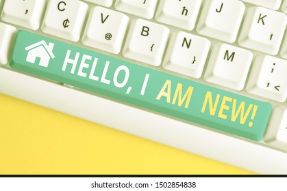 Text sign showing Hello I Am New. Conceptual photo used as greeting or to begin telephone conversation White pc keyboard with empty note paper above white background key copy space.
