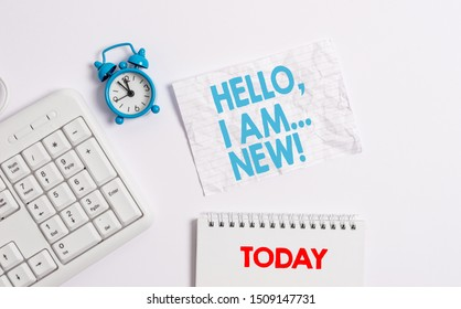 Text sign showing Hello I Am New. Conceptual photo used greeting or begin telephone conversation Blank paper with copy space on the table with clock and pc keyboard.
