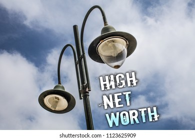 Text sign showing High Net Worth. Conceptual photo having high-value Something expensive A-class company Double Light post sky enlighten ideas message cloud cloudy beautiful.