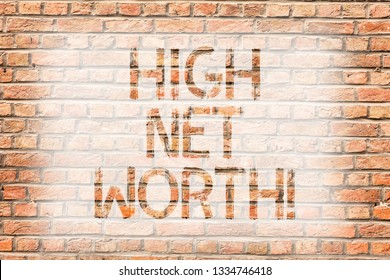 Text sign showing High Net Worth. Conceptual photo having highvalue Something expensive Aclass company Brick Wall art like Graffiti motivational call written on the wall.