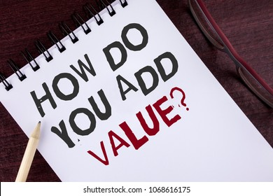 Text sign showing How Do You Add Value Question. Conceptual photo Bring business progress contribute earn written Notepad the Wooden background Pencil and Glasses next to it.