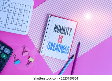 Text sign showing Humility Is Greatness. Conceptual photo being Humble is a Virtue not to Feel overly Superior Writing equipments and computer stuffs placed above colored plain table.