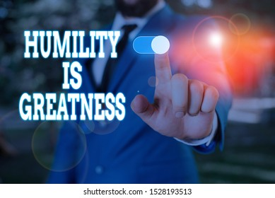 Text sign showing Humility Is Greatness. Conceptual photo being Humble is a Virtue not to Feel overly Superior Male human wear formal work suit presenting presentation using smart device.