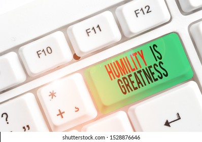 Text sign showing Humility Is Greatness. Conceptual photo being Humble is a Virtue not to Feel overly Superior White pc keyboard with empty note paper above white background key copy space.