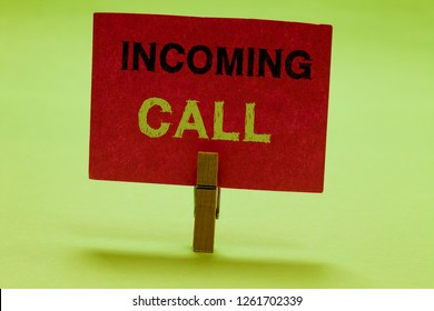 Text sign showing Incoming Call. Conceptual photo Inbound Received Caller ID Telephone Voicemail Vidcall Clothespin holding red paper important communicating messages ideas.