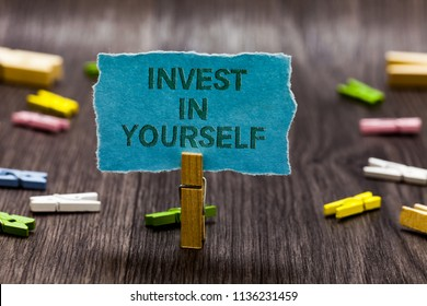 Text sign showing Invest In Yourself. Conceptual photo Improve your Skills take courses Do masters Scholarship Clips symbol idea script notice board text capital cardboard design.