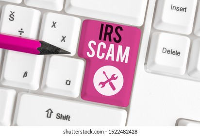 Text sign showing Irs Scam. Conceptual photo targeted taxpayers by pretending to be Internal Revenue Service White pc keyboard with empty note paper above white background key copy space.