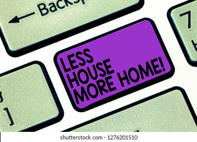 Text sign showing Less House More Home. Conceptual photo Have a warm comfortable place to live with family love Keyboard key Intention to create computer message pressing keypad idea.
