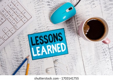 Text sign showing Lessons Learned. Conceptual photo the knowledge or understanding gained by experience technological devices colored reminder paper office supplies keyboard mouse.