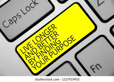 Text sign showing Live Longer And Better By Finding Your Purpose. Conceptual photo Look for a goal set mission Keyboard yellow key Intention create computer computing reflection document.