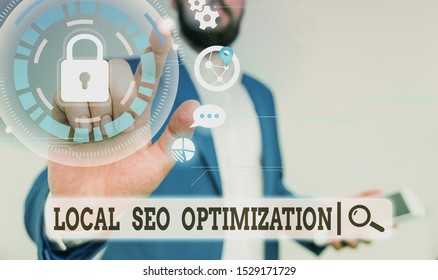 Text sign showing Local Seo Optimization. Conceptual photo increase Search Visibility to Rank on Top list Male human wear formal work suit presenting presentation using smart device.