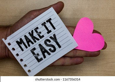 Text sign showing Make It Easy. Conceptual photo Smart approach Effortless Free from worries or difficulties Man holding piece notebook paper heart Romantic ideas messages feelings.
