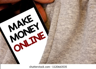 Text sign showing Make Money Online. Conceptual photo Business Ecommerce Ebusiness Innovation Web Technology Words written black Phone white Screen Hand holding pocket white tracksuit.