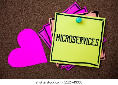 Text sign showing Microservices. Conceptual photo Software development technique Decomposing an application Multi colour small sticky boarder notice board thumb pinned heart display.