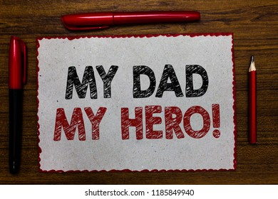 Text sign showing My Dad My Hero. Conceptual photo Admiration for your father love feelings emotions compliment Red bordered white page centered some texts wooden desk pen pencil.
