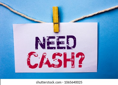 Text sign showing Need Cash Question. Conceptual photo Wealth Question Needy Currency Money Advice Conceptual written on White Note Paper hanging with rope on the plain background Clip.