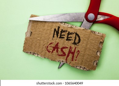 Text sign showing Need Cash Question. Conceptual photo Wealth Question Needy Currency Money Advice Conceptual written on Tear Cardboard on the plain background with Scissor.