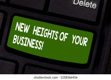 Text sign showing New Heights Of Your Business. Conceptual photo Achieving goals fast growing up company Keyboard key Intention to create computer message pressing keypad idea.