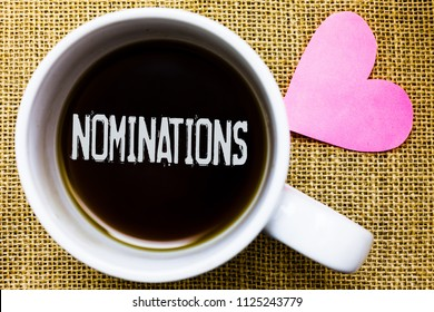 Text sign showing Nominations. Conceptual photo Suggestions of someone or something for a job position or prize Tea time coffee cup office typing work jute rough background love heart.