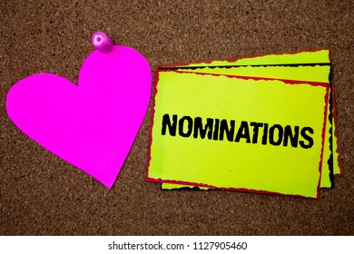 Text sign showing Nominations. Conceptual photo Suggestions of someone or something for a job position or prize Border sticky remember cards love heart pinned dark brown background.