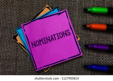 Text sign showing Nominations. Conceptual photo Suggestions of someone or something for a job position or prize Multiple colour sticky remember cards pen script marker jute background.