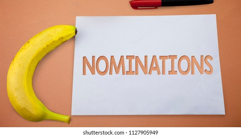 Text sign showing Nominations. Conceptual photo Suggestions of someone or something for a job position or prize Small paper drawing lines office work refreshment banana plane background.