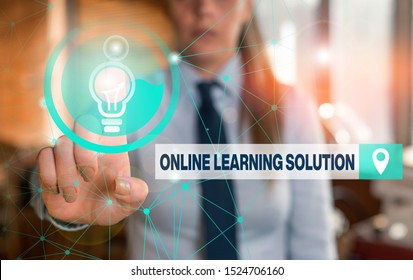 Text sign showing Online Learning Solution. Conceptual photo use of Electronic access to Educational Curriculum Female human wear formal work suit presenting presentation use smart device.