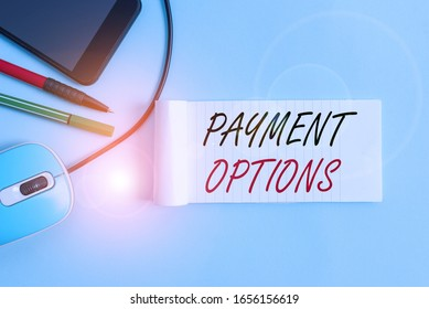 Text sign showing Payment Options. Conceptual photo ways that a customers can pay for the goods and services Notebook and writing equipment with modern gadget above pastel backdrop.