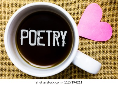 Text sign showing Poetry. Conceptual photo Literary work Expression of feelings ideas with rhythm Poems writing Tea time coffee cup office typing work jute rough background love heart.