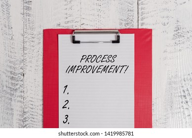 Text sign showing Process Improvement. Conceptual photo Optimization Meet New Quotas Standard of Quality Colored clipboard blank paper sheet old retro wooden vintage background.