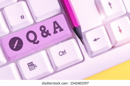 Text sign showing Q And A. Conceptual photo defined as questions being asked and answers White pc keyboard with empty note paper above white background key copy space.