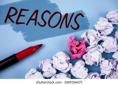 Text sign showing Reasons. Conceptual photo Causes Explanations Justifications for an action or event Motivation written on Painted background Crumpled Paper Balls and Marker next to it.