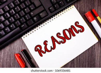 Text sign showing Reasons. Conceptual photo Causes Explanations Justifications for an action or event Motivation written on Notepad on wooden Grey background Marker and Black Keyboard next to it.