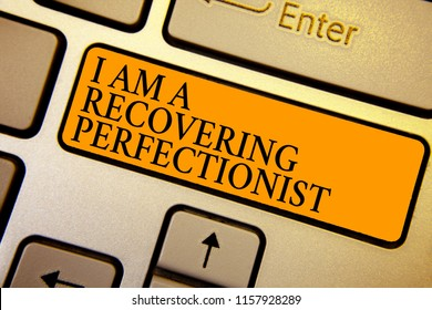 Text sign showing I Am A Recovering Perfectionist. Conceptual photo Obsessive compulsive disorder recovery Keyboard orange key Intention create computer computing reflection document.