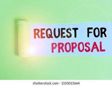 Text sign showing Request For Proposal. Conceptual photo document contains bidding process by agency or company Cardboard which is torn in the middle placed above a plain table backdrop.