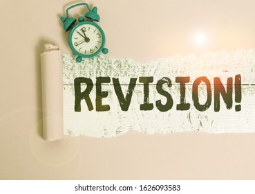 Text sign showing Revision. Conceptual photo action of revising over someone like auditing or accounting Alarm clock and torn cardboard placed above a wooden classic table backdrop.