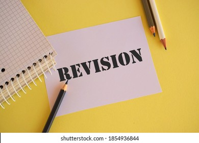 Text sign showing Revision. Conceptual photo action of revising over someone like auditing or accounting.White paper with text REVISION.