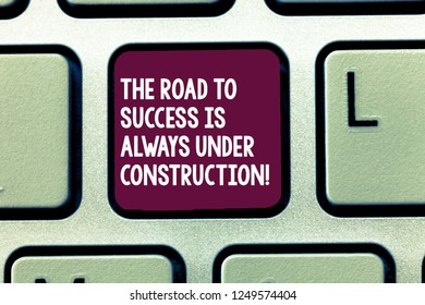 Text sign showing The Road To Success Is Always Under Construction. Conceptual photo In continuous improvement Keyboard key Intention to create computer message, pressing keypad idea.