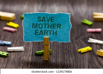 Text sign showing Save Mother Earth. Conceptual photo doing small actions prevent wasting water heat energy Clips symbol idea script notice board text capital cardboard design.