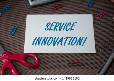 Text sign showing Service Innovation. Conceptual photo Improved Product Line Services Introduce upcoming trend Scissors and writing equipments plus plain sheet above textured backdrop.