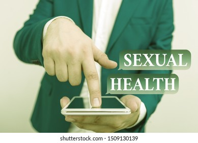 Text sign showing Sexual Health. Conceptual photo Healthier body Satisfying Sexual life Positive relationships Businessman in the blue suite with lap top pointing with finger.