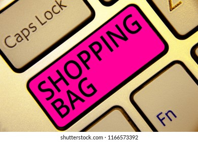 Text sign showing Shopping Bag. Conceptual photo Containers for carrying personal possessions or purchases Keyboard pink key Intention create computer computing reflection document.
