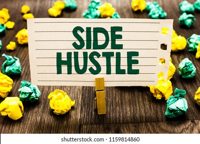 Text sign showing Side Hustle. Conceptual photo way make some extra cash that allows you flexibility to pursue Clothespin holding notebook paper crumpled papers several tries mistakes.