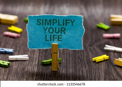 Text sign showing Simplify Your Life. Conceptual photo Manage your day work Take the easy way Organize Clips symbol idea script notice board text capital cardboard design.